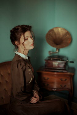 Felicia Simion BRUNETTE WOMAN SITTING IN HOUSE WITH GRAMOPHONE Women