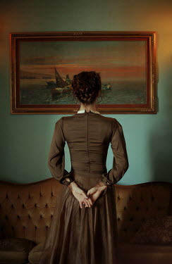 Felicia Simion WOMAN LOOKING AT PAINTING IN HOUSE FROM BEHIND Women