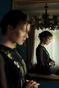 Felicia Simion WOMAN STANDING IN HOUSE REFLECTED IN MIRROR Women