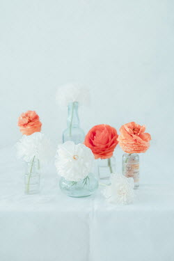 Magdalena Wasiczek ORANGE AND WHITE FLOWERS IN GLASS BOTTLES Flowers