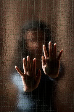 Mohamad Itani WOMAN WITH HANDS PRESSED ON GLASS INDOORS Women