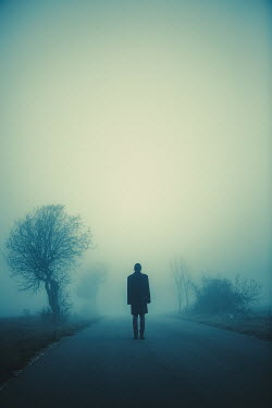Magdalena Russocka man standing on foggy road