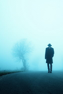 Magdalena Russocka man walking on foggy road