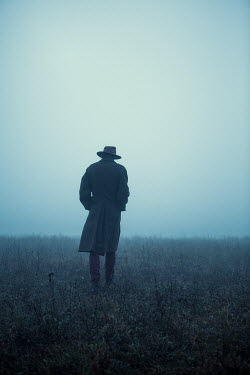 Magdalena Russocka man walking in foggy field