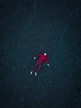 Magdalena Russocka aerial viwe of man's dead body lying on field