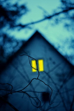 Magdalena Russocka light in window of house at night