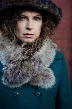 Magdalena Russocka close up of retro woman in blue coat and fur collar