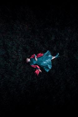 Rekha Garton WOMAN LYING IN FIELD AT NIGHT FROM ABOVE Women