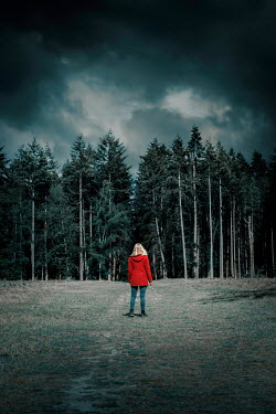 Rekha Garton WOMAN STANDING BY FOREST WITH STORMY SKY Women