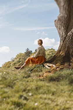 Shelley Richmond WOMAN SITTING BY TREE IN SUMMERY COUNTRYSIDE Women