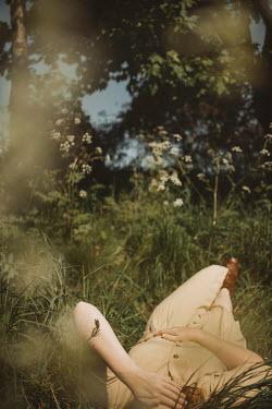 Shelley Richmond WOMAN LYING IN SUMMERY COUNTRYSIDE Women
