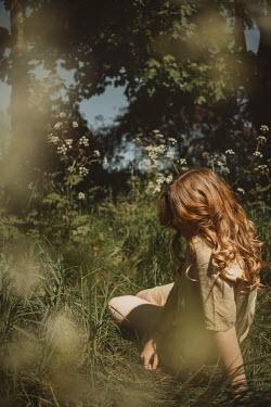 Shelley Richmond WOMAN SITTING RELAXING IN IN SUMMERY COUNTRYSIDE Women