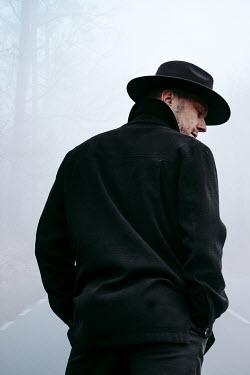 Magdalena Russocka close up of man wearing fedora hat