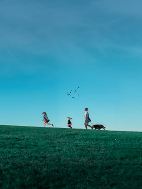 Mary Wethey MOTHER AND DAUGHTERS WALKING DOG IN FIELD Groups/Crowds