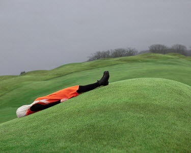 Patty Maher GIRL WITH WHITE HAIR LYING ON GREEN HILL Women