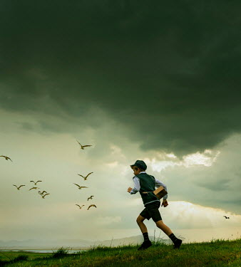 Stephen Mulcahey BOY RUNNING BY LAKE WITH STORMY SKIES Children