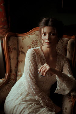 Felicia Simion BRUNETTE WOMAN IN WHITE LACE SITTING INDOORS Women