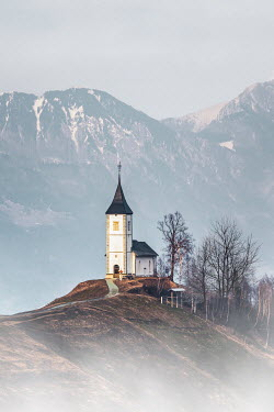 Evelina Kremsdorf CHURCH ON HILL WITH SNOWY MOUNTAINS Religious Buildings