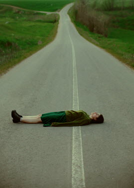 Felicia Simion WOMAN LYING IN COUNTRY ROAD Women