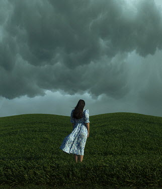 Felicia Simion WOMAN STANDING IN FIELD WATCHING STORMY CLOUDS Women