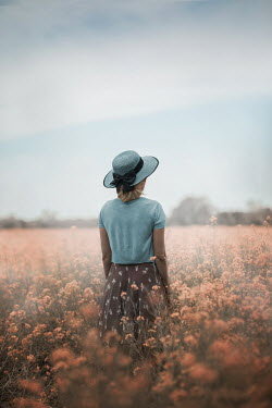 Ildiko Neer Blonde hair woman standing in flower field