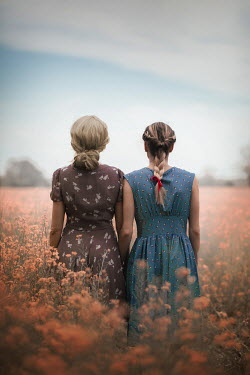 Ildiko Neer Two women standing in flower field
