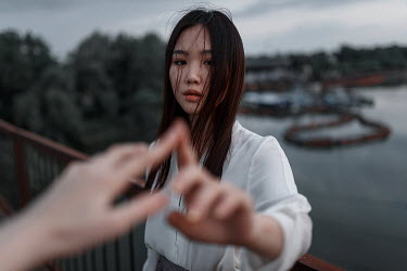 Ulyana Naydenkova ASIAN GIRL TOUCHING FINGERS BY WATER Women