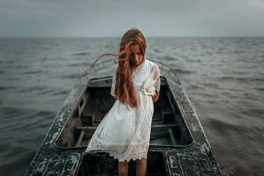Ulyana Naydenkova GIRL WITH RED HAIR STANDING IN BOAT ON SEA Children