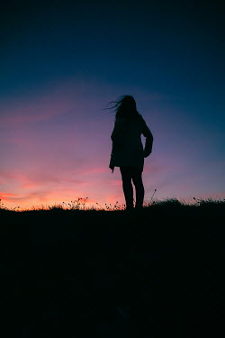Marie Carr SILHOUETTED GIRL STANDING IN COUNTRYSIDE AT SUNSET Women