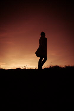 Marie Carr SILHOUETTED GIRL WALKING IN COUNTRYSIDE AT SUNSET Women