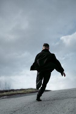 Magdalena Russocka modern man running on empty road