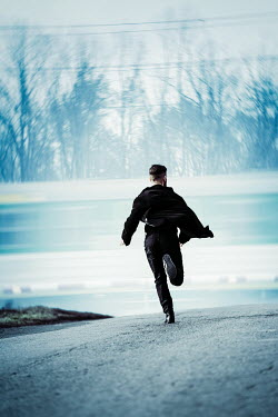 Magdalena Russocka modern man running toward moving train