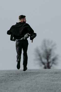 Magdalena Russocka modern man running on empty road