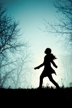 Magdalena Russocka SILHOUETTED GIRL WALKING BY TREEES IN FOG Women