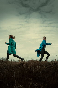 Rekha Garton TWO BLONDE GIRLS RUNNNG IN FIELD Women