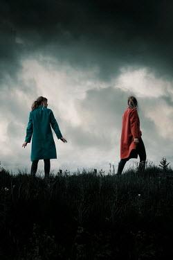 Rekha Garton TWO GIRLS IN FIELD WITH STORMY SKY Women