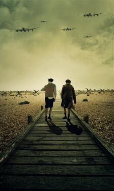 Stephen Mulcahey GIRL AND BOY ON BEACH WITH WAR PLANES Children