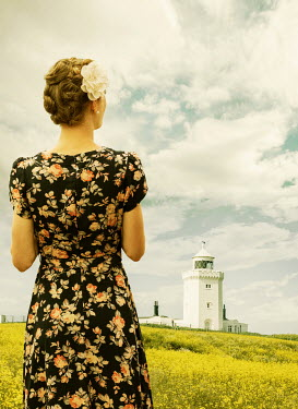 Stephen Mulcahey WOMAN IN FLORAL DRESS WATCHING LIGHTHOUSE Women