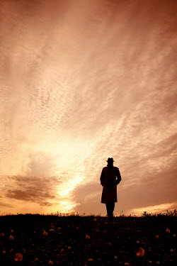 Tim Robinson MAN IN HAT STANDING FIELD AT SUNSET Men