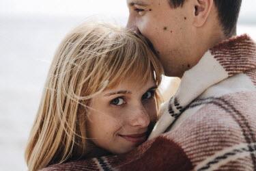Alina Zhidovinova HAPPY MODERN COUPLE EMBRACING BY SEA Couples