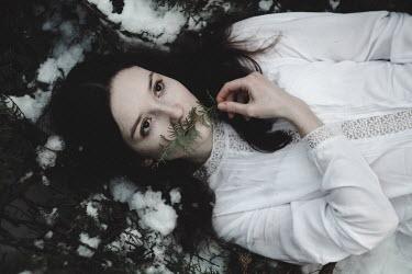 Alina Zhidovinova WOMAN IN WHITE LYING ON SNOWY GROUND Women