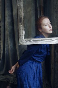 Alina Zhidovinova WOMAN WITH RED HAIR STANDING BY OPEN WINDOW Women