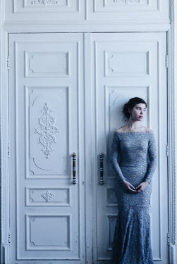 Alina Zhidovinova WOMAN IN LACY DRESS STANDING BY CLOSED DOORS Women
