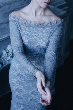 Alina Zhidovinova WOMAN IN BLUE LACY DRESS BY FIREPLACE Women