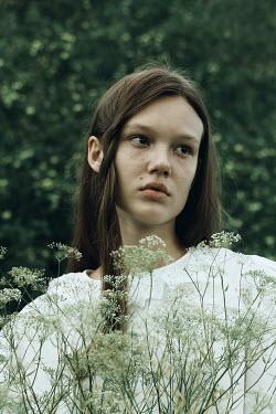 Alina Zhidovinova SAD GIRL IN WHITE DRESS WITH FLOWERS OUTDOORS Children