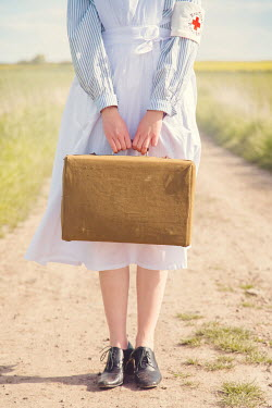 Joanna Czogala RETRO NURSE CARRYING CASE ON COUNTRY ROAD Women