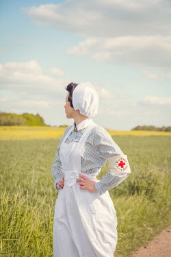 Joanna Czogala RETRO NURSE STANDING ON COUNTRY ROAD Women