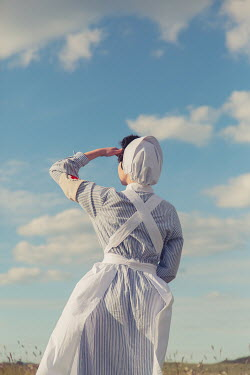 Joanna Czogala RETRO NURSE WATCHING BLUE SKY FROM BEHIND Women