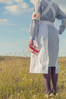 Joanna Czogala RETRO NURSE HOLDING LETTERS IN COUNTRYSIDE Women