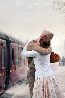 Lee Avison 1940s couple embracing on a railway platform